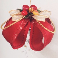 Classic Christmas. Our tree has never had a year without a twirl of red ribbon! Your purchase of our ornaments will help bring the bright season to families from our city's poorer neighborhoods.